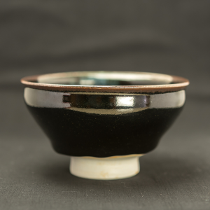 Black glazed porcelain tea bowl with blue comet by Michel François