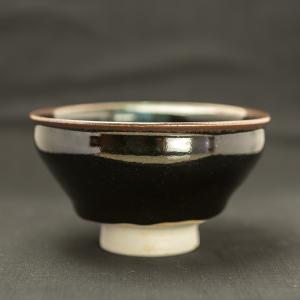 Bol à thé à glaise noire en porcelaine avec une comète bleue de Michel François