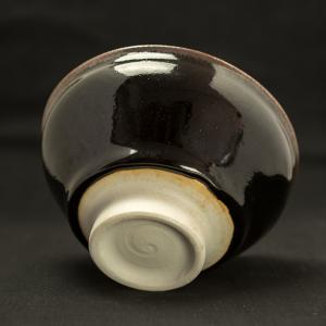 Black glazed porcelain tea bowl with blue comet by Michel François